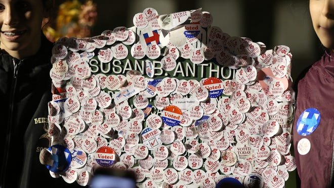 The sign telling the history of Susan B. Anthony's  was also covered in stickers.
