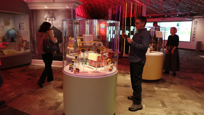 David DuBois of East Aurora and a member of the Little People team at Fisher-Price takes a photo of the display.