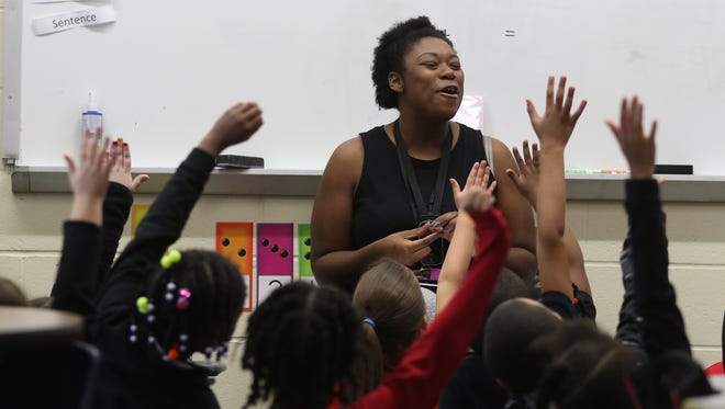 Oscia Miles reviews with the first-grade class what they learned about Martin Luther King Jr.