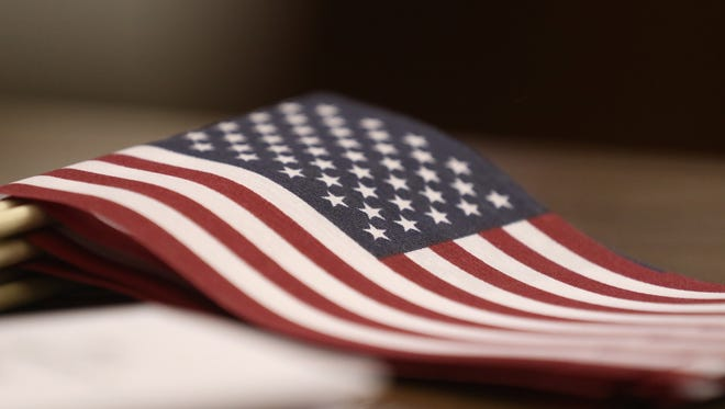 A small flag sits on a desk.