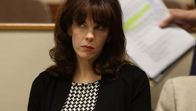 Laura Rideout watches as the prosecution gets up to question a witness.