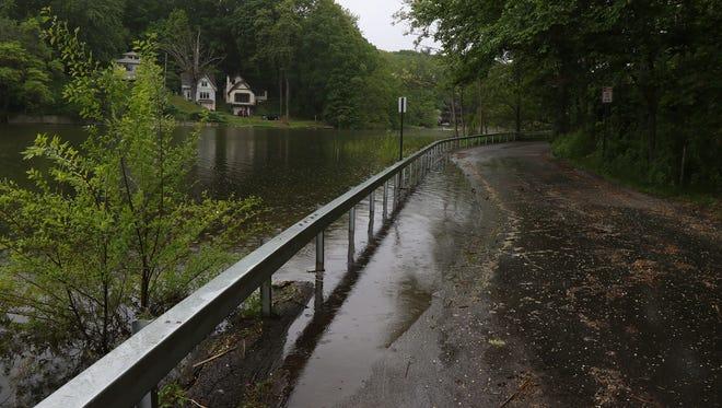Irondequoit Bay overflows onto Seneca Road in Irondequoit.