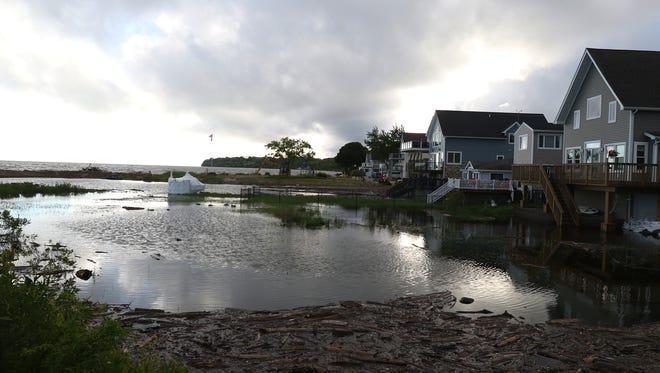Several homes facing Lake Ontario on Lake Road in Webster near Irondequoit Bay. A sandbar has helped slow the waves.