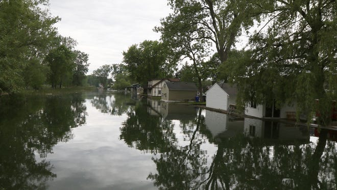 A small creek that flows from Lake Ontario on Edgemere Drive overflowed its banks in June.