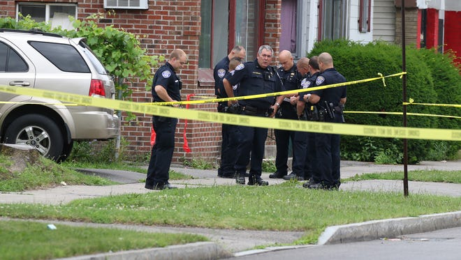 A city man was found dead behind a residence at 675 Maple Street.