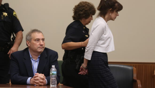 Paul Tucci sits waiting to hear what the judge is going to say while Laura Rideout is led out of the courtroom to jail.