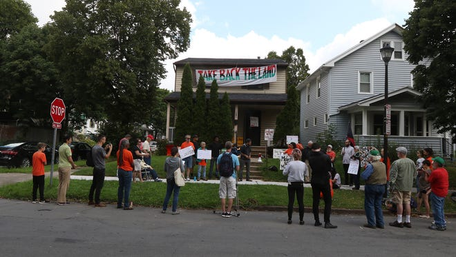 Members of Take Back the Land and supporters held a rally at Liz McGriff's home on Cedarwood Terrace.