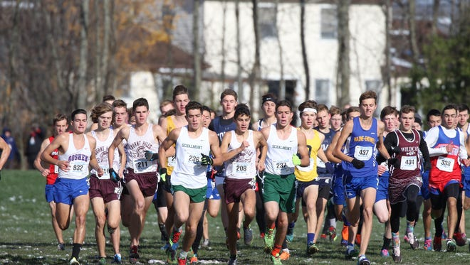 A pack of boys approach the first turn during Saturday's Class B state championship race.