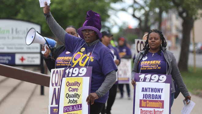 Unionized employees at Anthony Jordan Health Center  on Holland Street strike because of the lack of a contract.  They said they accepted the federal mediator's proposal but the health center did not.  Leading the chant is Susan James of Rochester, a dental receptionist.  Behind her are Tammy Anderson and Keturah Moore both of Rochester and nutrition assistants in the WIC program.