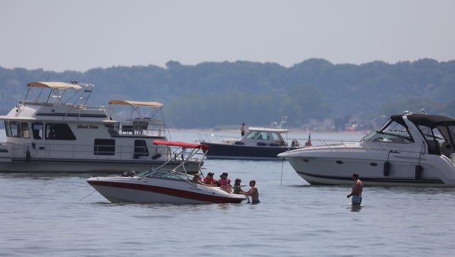 Boaters relax in and on Lake Ontario on Sunday, June 17, 2018.