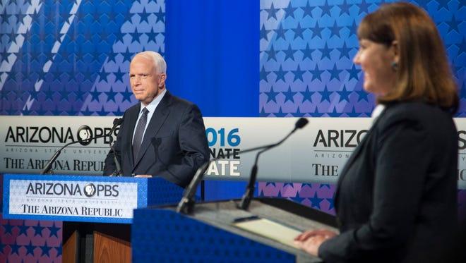 U.S. Senate candidates Rep. Ann Kirkpatrick and incumbent Sen. John McCain talk before their only debate on Arizona PBS on Oct.10, 2016, in Phoenix, Ariz.