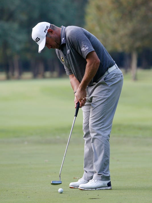 Britain's Lee Westwood hits the ball during the 73th Italy Open Golf Championship in Monza, Italy, Thursday, Sept. 15, 2016. (AP Photo/Antonio Calanni)