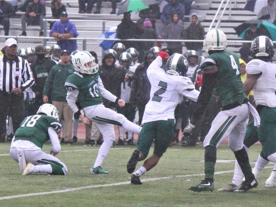 West Bloomfield's Nick O'Shea hits the first of his three field goals, accounting for all of his team's scoring in the Lakers' 9-7 semifinal victory over Detroit Cass Tech.