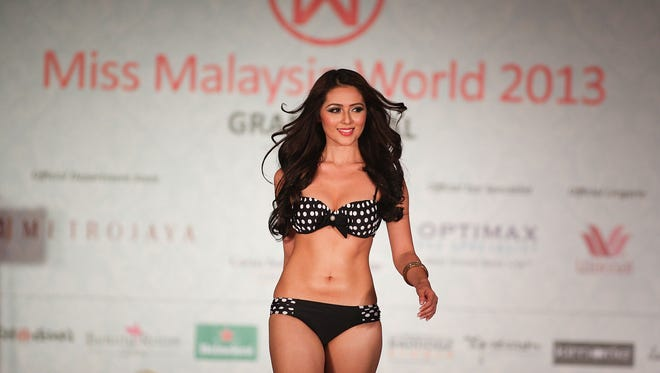 The winner of Miss Malaysia World 2013, Melinder Kaur Bhullar walks on stage at the Miss Malaysia World 2013 finale on Aug. 2, 2013 in Kuala Lumpur, Malaysia. Four Muslim women were dropped as contestants after being barred from participating due to a religious decree issued by the Malaysian Islamic National Fatwa Council Committee. The Miss World competition will be held in Indonesia, the largest Muslim country in the world.