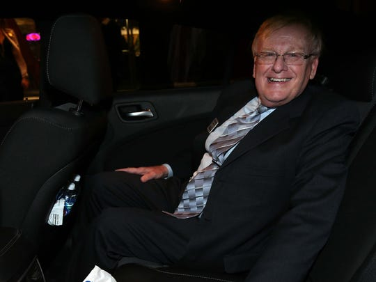Mayor Pro Tem Ken McClure enjoys one of Springfield's first-ever Uber rides outside the launch party at the Vandivort Hotel in Springfield on November 17, 2016.