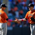 May 11, 2014; Baltimore, MD, USA; Houston Astros teammates Jason Castro (15) and Marc Krauss (18) celebrate after a game against the Baltimore Orioles at Oriole Park at Camden Yards. The Astros defeated the Orioles 5-2. Mandatory Credit: Joy R. Absalon-USA TODAY Sports