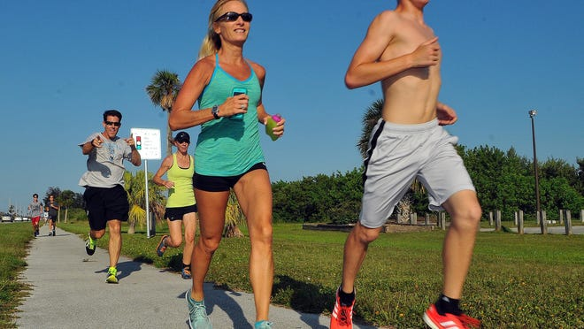 Members of the Cocoa Beach Fun Run/Walk Club meet at Long Doggers in Cocoa Beach, along with Florida Today's Michelle Mulak Wednesday for a 3 to 4 mile run heading west on SR520 and back .