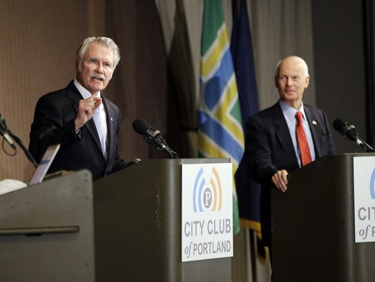 Oregon Gov. John Kitzhaber, left speaks as Republican