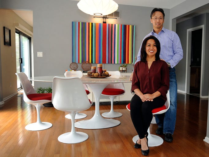 Arlene and Eddie Dimaguila in the dining room of their
