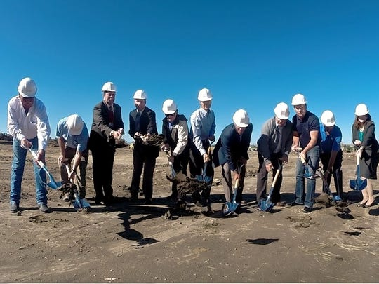 Dignitaries and developers break ground at the site of Talus Apartment Home just south of Benefis Health System Tuesday morning.