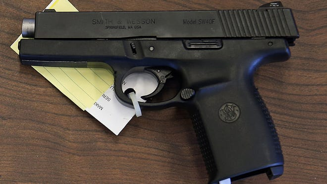 A Smith & Wesson .40-caliber semi-automatic pistol photographed at the Indianapolis Metropolitan Police Department.