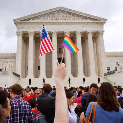The crowd celebrates outside of the Supreme Court in