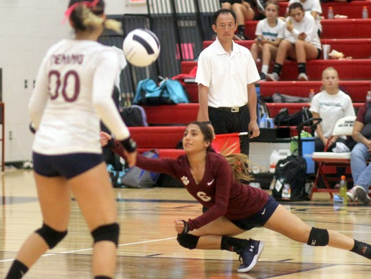 Senior Myka Trevizo scrambles to come up with the dig