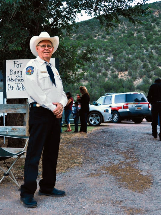 Lincoln County Sheriff's Posse President Marty Jackson mans the parking area at a Lincoln County event Sunday.