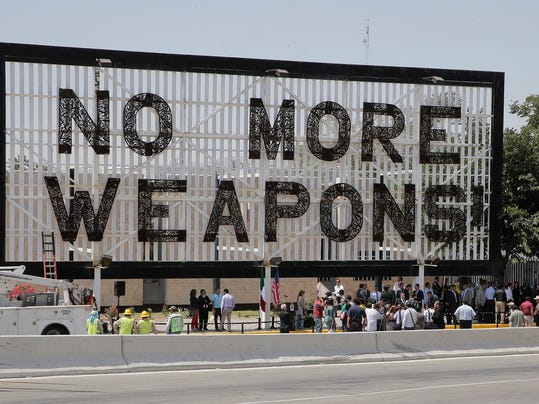 """Work crews begin the task of tearing down the billboard that has greeted visitors to Juárez, Mexico for the past three years. The """"No More Weapons"""" billboard constructed with those same weapons that were being brought into Mexico illegally, """"was not the message that Mexico wants to send to its visitors,"""" said Chihuahua Gov. C sar Duarte as he addressed several invited dignitaries and local municipal leaders and gave the signal to workers to begin work on bringing down the billboard that was unveiled in 2012."""