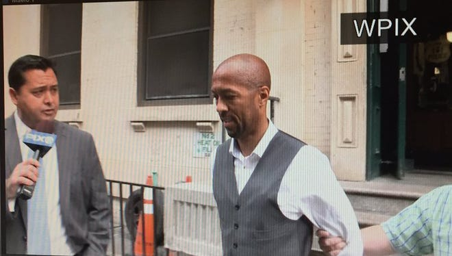 In this still from Pix 11 News (pix11.com) Charles Pugh, 44, is arrested Thursday, June 23, 2016 in New York City on child-molestation charges filed in Detroit.