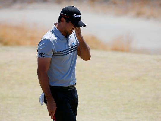Jason Day, of Australia, wipes his face on the third green during the third round of the U.S. Open golf tournament at Chambers Bay on Saturday, June 20, 2015 in University Place, Wash. (AP Photo/Matt York)