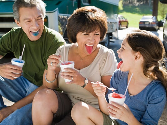 Family eating snow cones