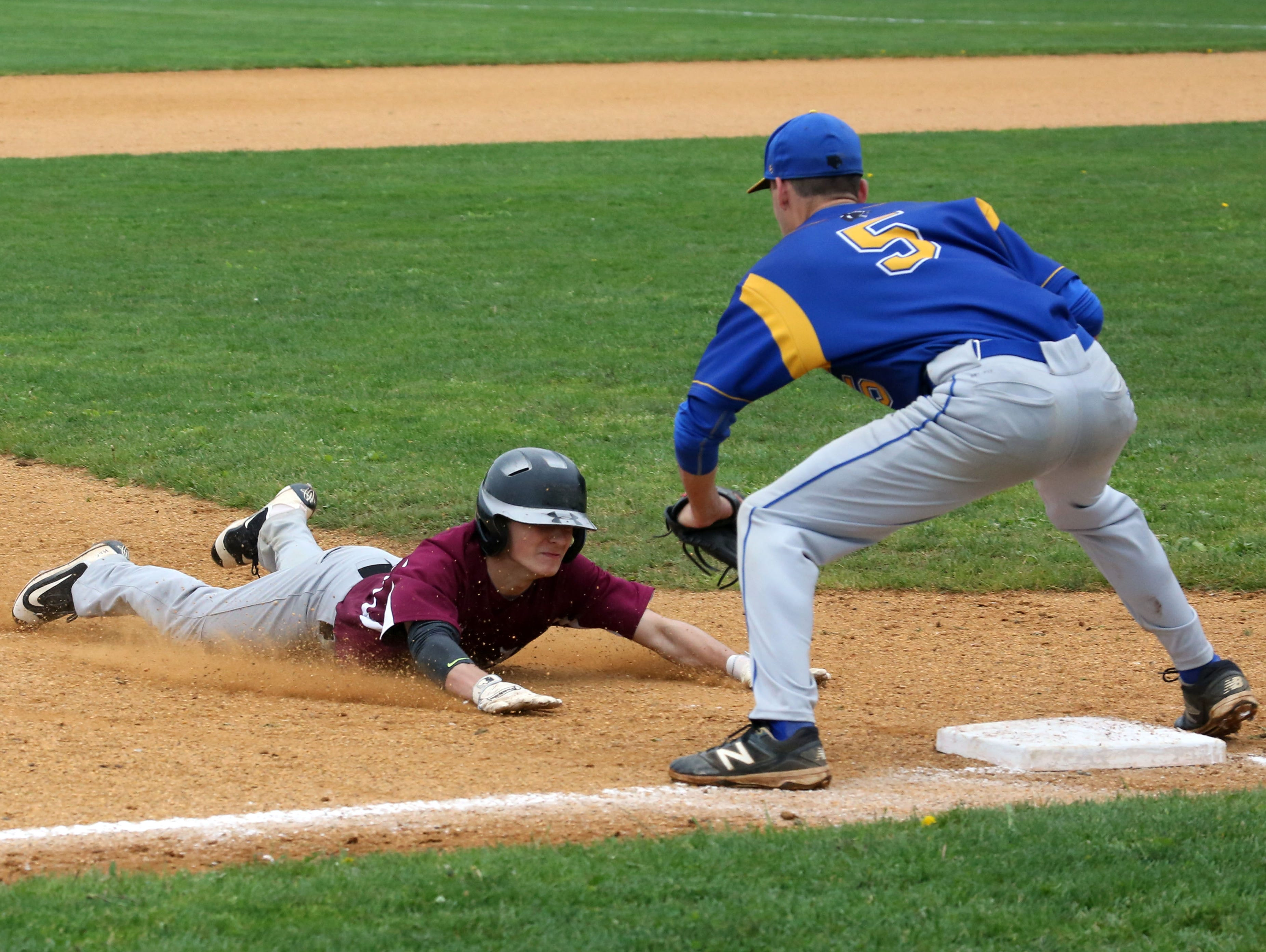 Albertus Magnus' Joe Ottaviano is out at third base as Ardsley's Peter Knights waits for him during their Class B game at Ardsley High School, May 21, 2016.