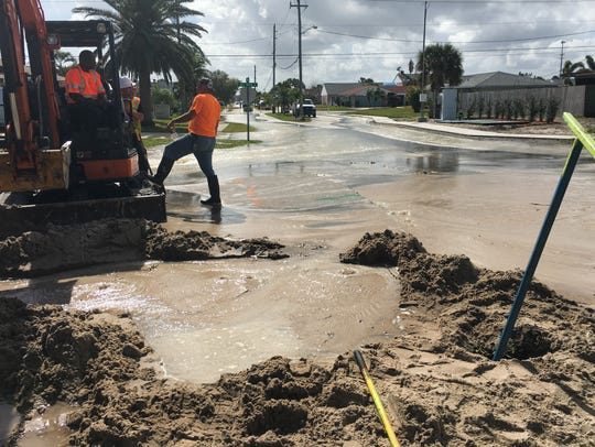 Crews work to repair a water main break at Bay Drive