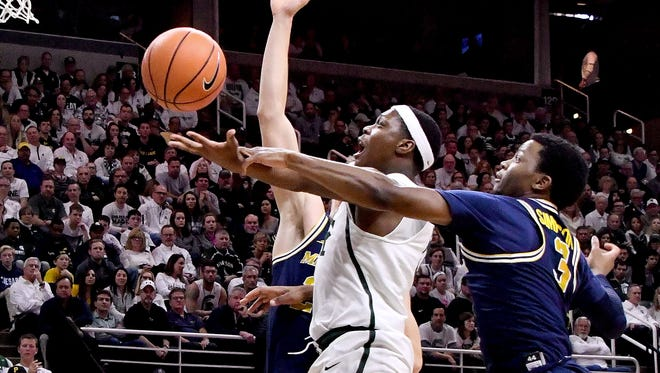"""Michigan State's Cassius Winston, middle, said the team is """"fighting out of the dog house"""" in practice this week."""
