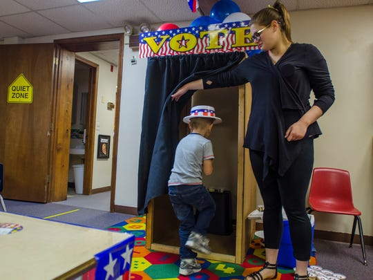 Carter Moyer walks into the election booth to pick his ice cream Monday, Nov. 7, during an election day ice cream party at the Marysville Children's Center.