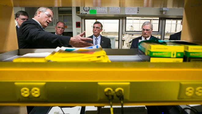 Tim Mueller (left), vice president of science and technology, shows one of the lab areas as he gives Gov. John Carney a tour of the Delaware Innovation Space at the DuPont Experimental Station on Powder Mill Road.
