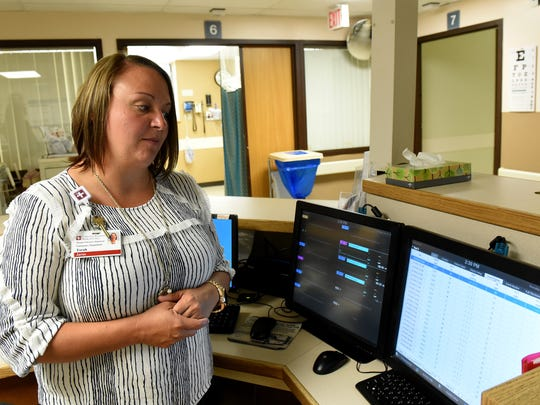 Tarah Jaras explains how the new telemetry system in the Emergency Room at the Coshocton Regional Medical Center helps nurses on that floor and others treat patients.