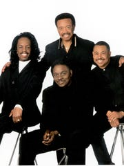 Legendary R&B musical group Earth, Wind, & Fire (left to right) Verdine White, Phillip Bailey (bottom, center), Maurice White, (top center) and Ralph Johnson, in May 2008.