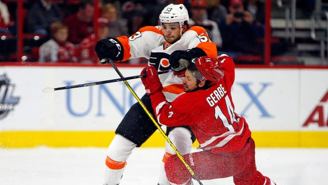 Shayne Gostisbehere had his first NHL assist in Saturday's overtime win over the Carolina Hurricanes.