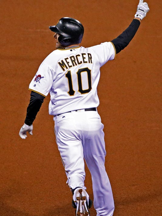 Pittsburgh Pirates' Jordy Mercer (10) celebrates driving in the game-winning run with a single off St. Louis Cardinals relief pitcher Seth Maness during the 11th inning of a baseball game in Pittsburgh, Tuesday, April 5, 2016. The Pirates won 6-5. (AP Photo/Gene J. Puskar)