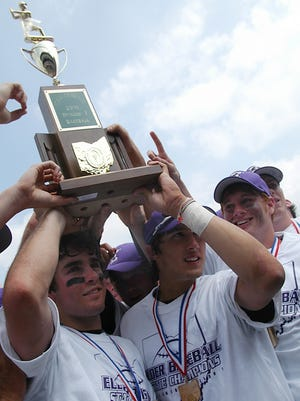 Former Elder baseball player Billy O'Conner, left, a 2005 Elder grad, was announced last month as the new head baseball coach at Xavier University. O'Conner's pictured here hoisting the Division I state championship trophy in 2005 after a 3-0 win over Toledo Start.