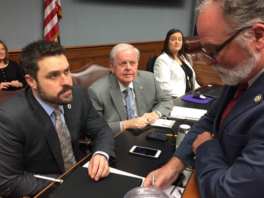 Reps. Blake Miguez, R-Erath, Bubba Chaney, R-Rayville, and Bob Hensgens, R-Abbeville, discuss the state budget Monday before the start of the House Appropriations Committee meeting.