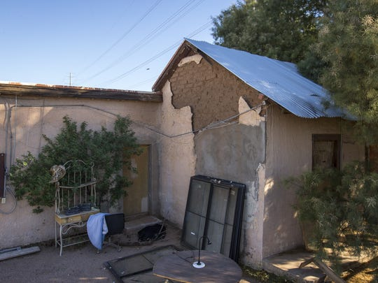 The plaster is falling off the 1860s adobe home Steve Sussex's great-grandparents build near downtown Tempe as seen Oct. 13, 2014.