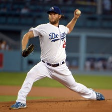 Sep 2, 2014; Los Angeles, CA, USA; Los Angeles Dodgers starter Clayton Kershaw (22) delivers a pitch against the Washington Nationals at Dodger Stadium. Mandatory Credit: Kirby Lee-USA TODAY Sports