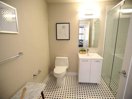 A bathroom in a furnished loft unit at Uno in Yonkers.