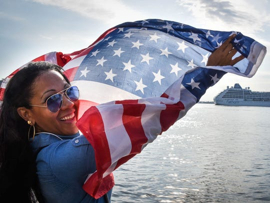 A Cuban waves a U.S. flag at the Malecon waterfront