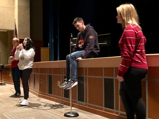 A Chambersburg Area Senior High School student shares her thoughts on school safety during an event for the National School Walkout the morning of Wednesday, March 14 in the auditorium.