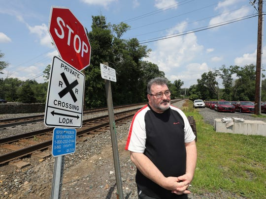 Bart Fitzsimons stands next to the private railroad