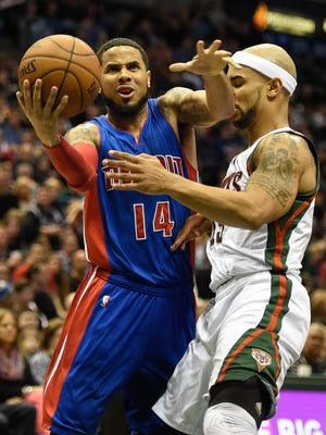 Detroit Pistons guard D.J. Augustin takes a shot against Milwaukee Bucks guard Jerryd Bayless in the second quarter.